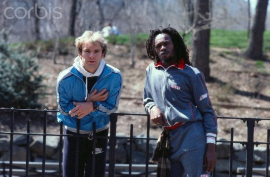 Sting and Michael Rose Leaning on a Fence
