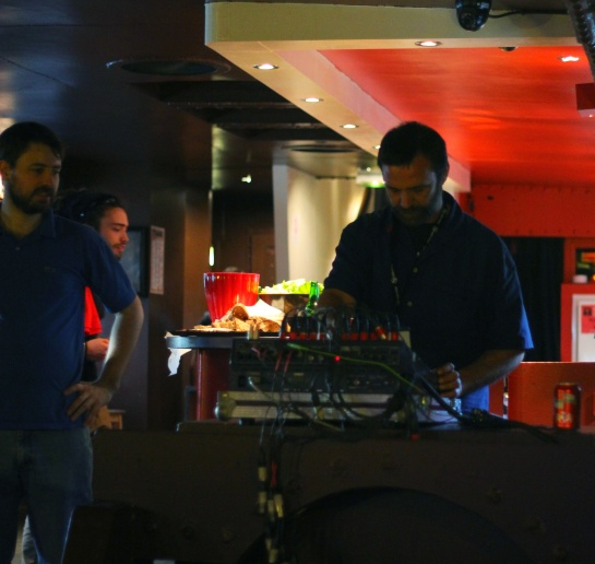 Patleg, sound engineer, setting up the desk, inside the boat - Photo : Fred reGGaeLover 2014