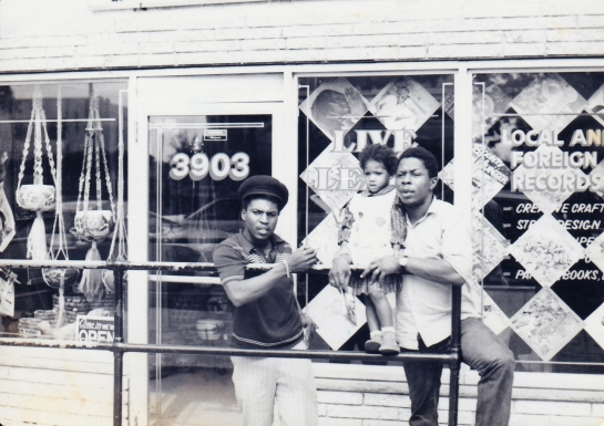 "Delroy Wright (l) & Earl ""Heptones"" Morgan (r w/ Wright's daughter), Live & Learn Records, 3903 Georgia Avenue, 1980"